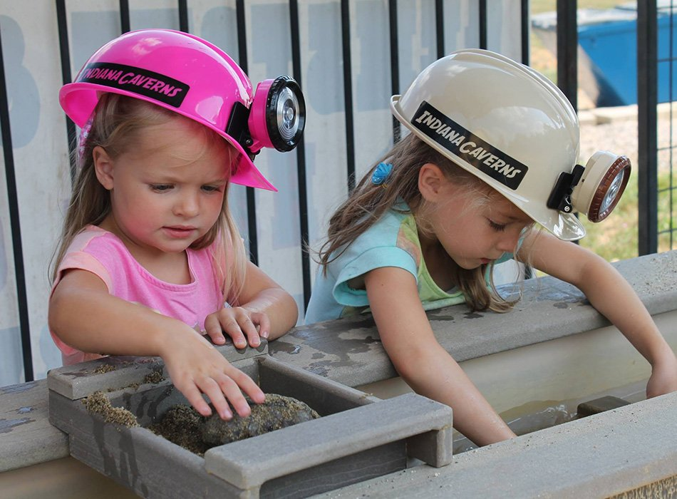 girls in sturdy caver helmets gemstone mining at Indiana Caverns