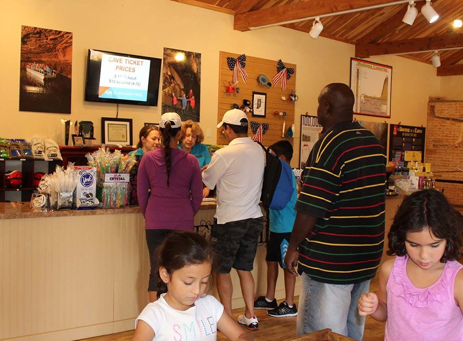 customers buying tickets at Indiana Caverns welcome center