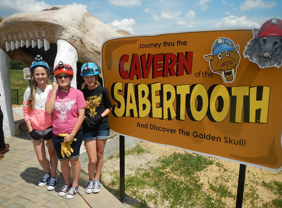 Girls outside of Sabertooth Caving Activity